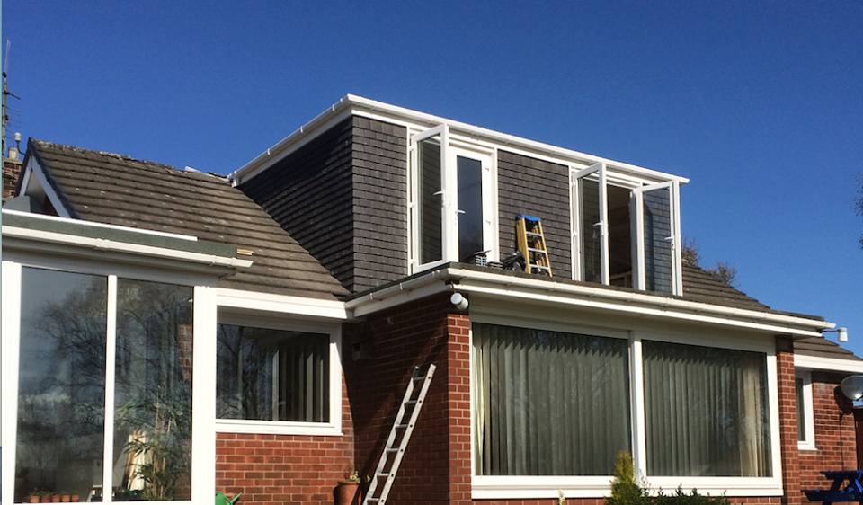 Cottage dormer loft conversion in Northwich, creating a large bedroom with Velux windows